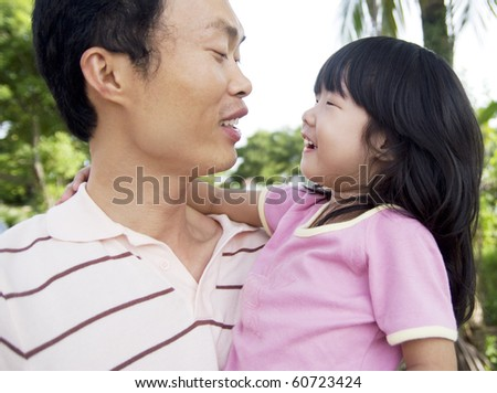 Asian father talking with daughter