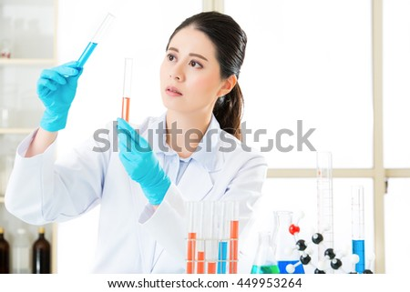 Asian female forensic scientist Research and development in laboratory - stock photo