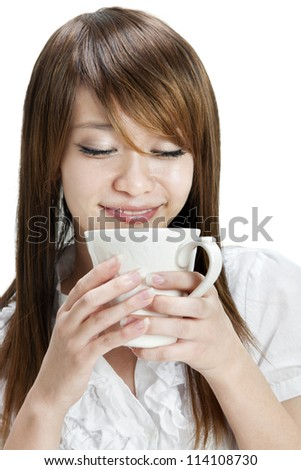 Asian female holding a cup over white background - stock photo
