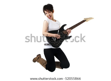Asian female rockstar holding guitar jumping in air. - stock photo