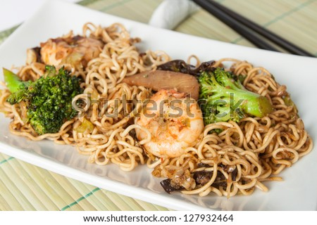 Asian food arranged on a white plate