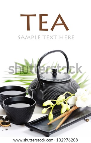 Asian food concept (Green tea, orchid and chopsticks) with sample text - stock photo