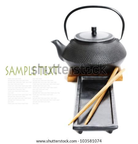 Asian food concept (Tea pot and chopsticks) with sample text - stock photo