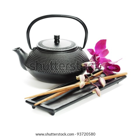 Asian food concept (Tea pot, orchid and chopsticks) - stock photo