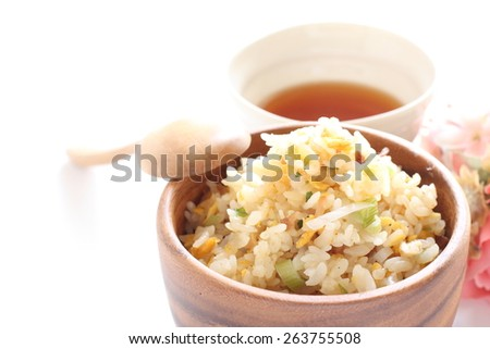 Asian food, egg and roasted pork fried rice with tea on background - stock photo