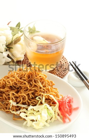 asian food, fried noodles with cabbage and pickled ginger