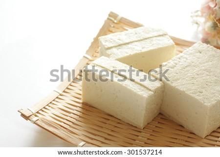 Asian food ingredeint, tofu on bamboo basket - stock photo