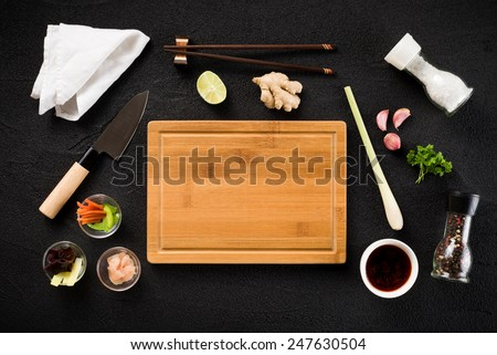 Asian food ingredients and cutting board top view - stock photo
