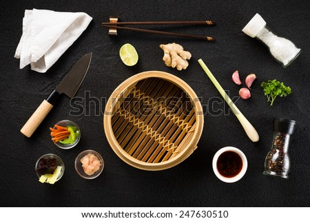 Asian food ingredients and steamer top view - stock photo