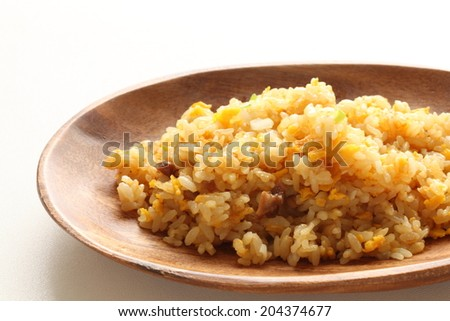 Asian food, roasted pork and egg fried rice on white background with copy space