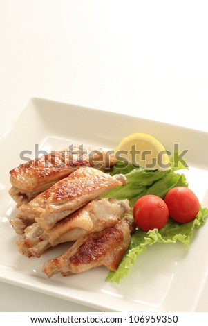 Asian food, tasty grilled chicken wing with freshness vegetable on side