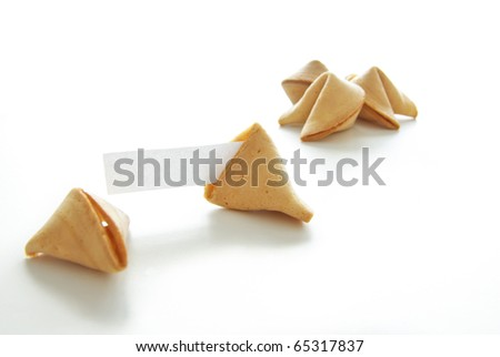 Asian fortune cookies with blank paper isolated on white background.