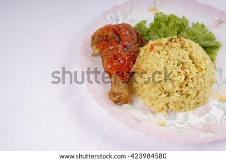 Asian fried rice nasi goreng with chicken, prawns, egg and vegetables horizontal view from above. DOF and copy space - stock photo