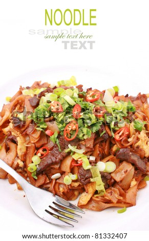 Asian fried rice noodles with beef isolated on white