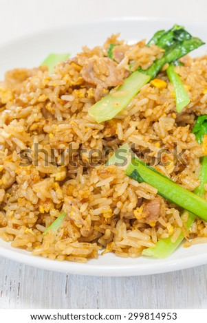 Asian fried rice with pork and vegetable