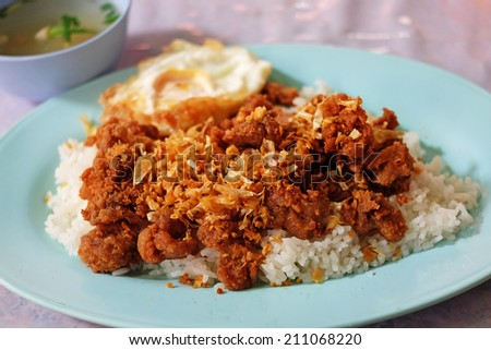 Asian fritter pork with rice and soup