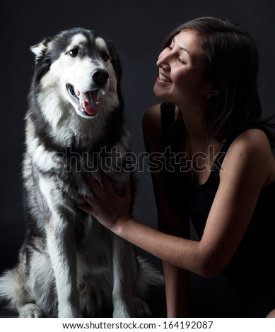Asian girl and a Siberian husky in the studio