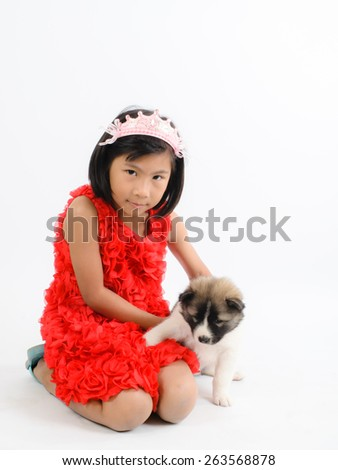 Asian girl and Thai Bang Kaew puppy isolated on white. - stock photo