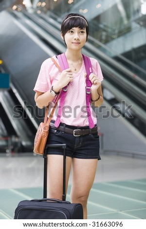 asian girl at singapore's changi airport terminal