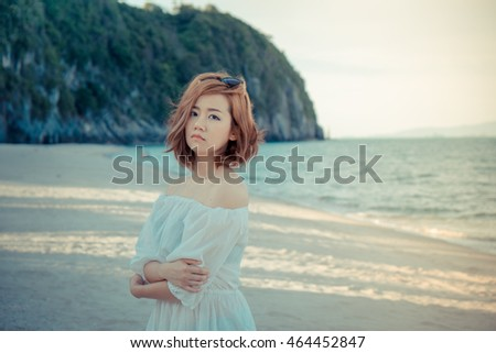 Asian girl at the beach. Girls waiting someone  on the beach. Woman at sea from Thailand. Vintage tone.
