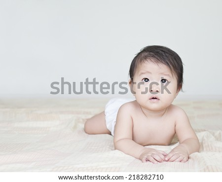 asian girl baby in the room - stock photo