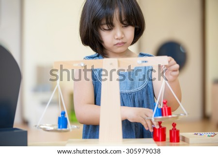Asian girl balance and thinking for solution in classroom,student thinking, looking for solution grey wall background. Face expressions - stock photo