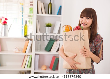 asian girl coming back from a shopping - stock photo