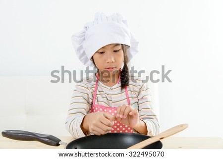 Asian girl cooking at home, food concept.