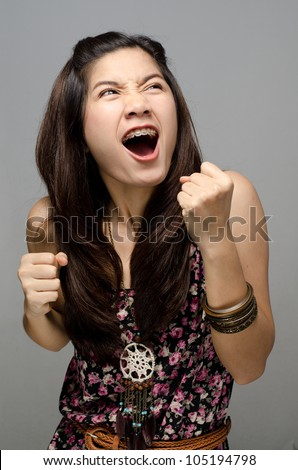 Asian girl do a winning face - stock photo