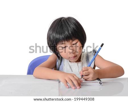 Asian girl doing homework at home, isolated on white. - stock photo