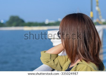 Asian girl from back angle,wear glasses
