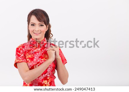 Asian girl greeting traditional chinese welcome stock photo asian girl greeting in traditional chinese welcome guest new year m4hsunfo