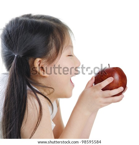 Asian girl holding an apple on white background - stock photo