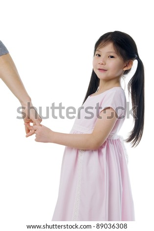 Asian girl holding her mother's hand - stock photo