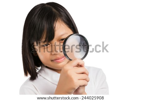 Asian girl holding magnifying glass isolated on white background. - stock photo
