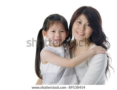 asian girl hugging her mother - stock photo