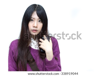 Asian girl in casual wear on white background
