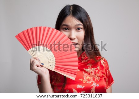 Asian girl in chinese cheongsam dress on gray background