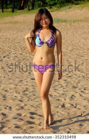 Asian girl in colorful bikini - stock photo