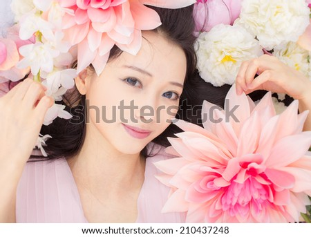 asian girl in flowers - stock photo