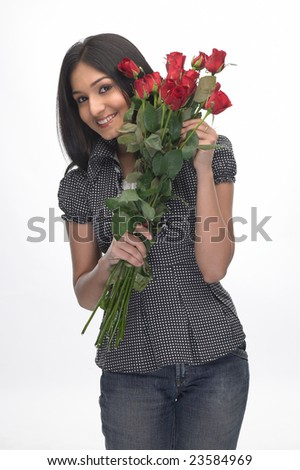 Asian girl in modern costume with bunch of red roses - stock photo