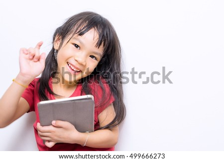 Asian girl is having funny using educational tablet