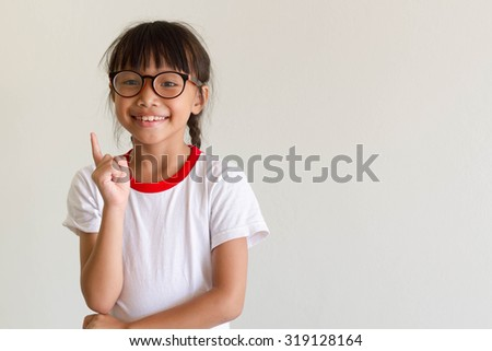 Asian girl kid is thinking for something and have a good idea