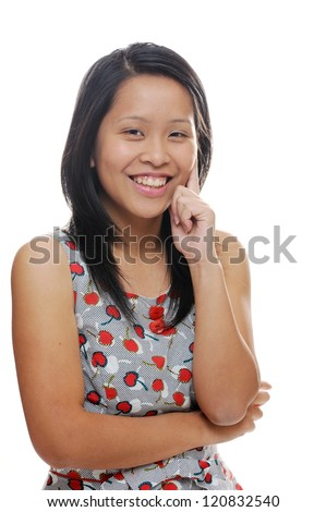 Asian girl laughing and looking cheerful - stock photo