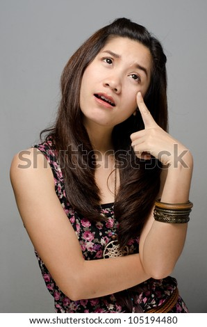 Asian girl looking and thinking - stock photo