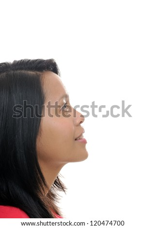 Asian girl looking up into white space - stock photo