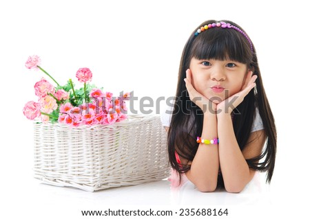 Asian girl lying on the floor with funny expression - stock photo