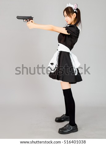 asian girl maid cosplay with gun japanese style