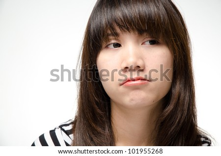 Asian girl making a bored face - stock photo
