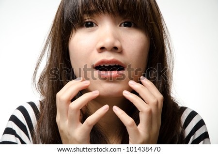 Asian girl on black and white shirt makes a shock face - stock photo